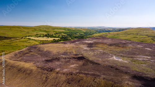 Valokuva  Aerial drone view of a large, buried landfill dump site in Wales