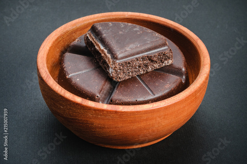 Traditional mexican chocolate bar in wooden bowl