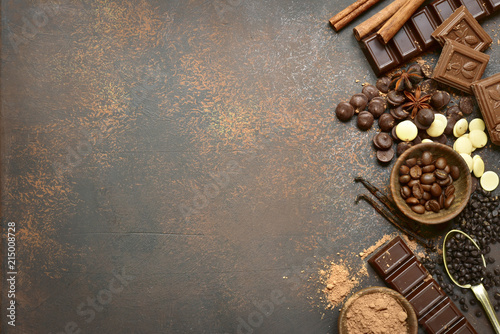 Ingredients for making chocolate cake or candy : chocolate chips, bar and spices.Top view with copy space.