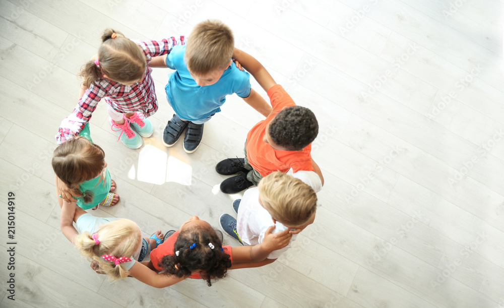 Fototapety, obrazy: Little children making circle with hands around each other indoors, top view. Unity concept