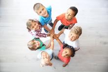 Little Children Putting Their ...