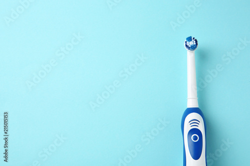 Photo  Electric toothbrush on color background. Dental care