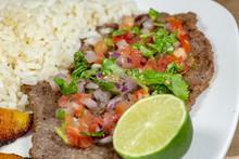 A Steak Covered In Pico De Gal...