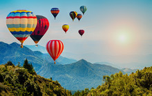 Beautiful View Of Mountain With Hot Air Balloons On Morning At Thailand.