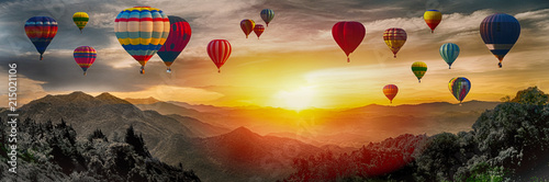 Aluminium Prints Balloon Dramatic panorama of mountain with hot air balloons at sunset,Thailand.