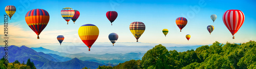 Obraz Panorama of mountain with hot air balloons on morning at Thailand. - fototapety do salonu