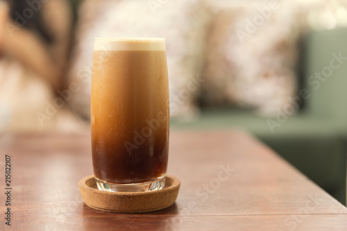 Cold brew or Nitro Coffee drink in the glass with bubble foam Poster Mural XXL