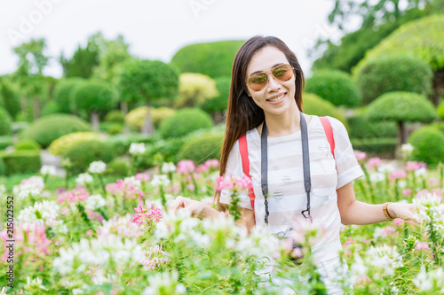 Asian teen travel in the green park garden relax in summer holiday Canvas-taulu