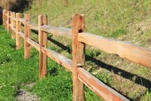 Split Rail Fence Along A Grassy Hillside