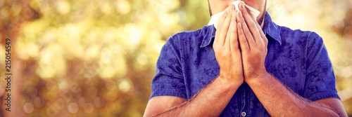 Obraz Handsome hipster blowing his nose - fototapety do salonu