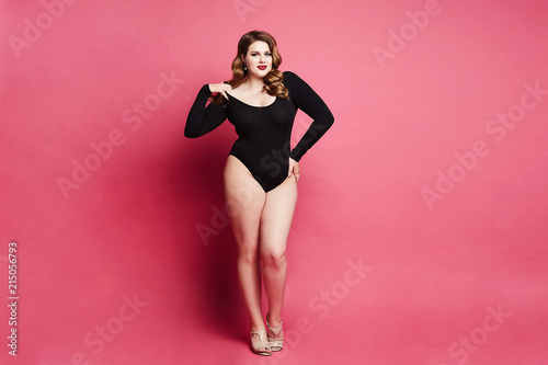 Fotografie, Tablou Plus size sexy model girl, fashionable blonde in black bodysuit, with bright mak