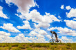 canvas print picture - A man rides on his bmx bicycle on a flat road in the Free state, South Africa.