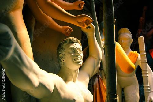A clay idol of a Mahishashura the arch nemesis of Goddess Durga under constructi Canvas Print