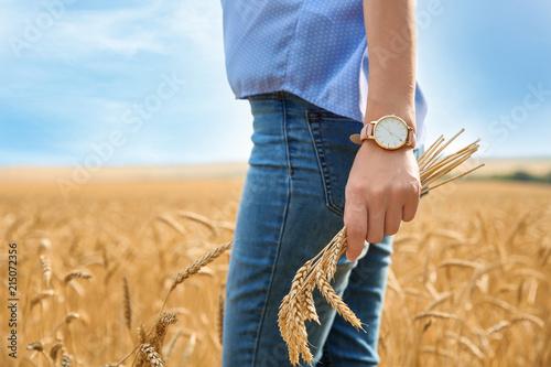 Fotografía  Young woman in grain field, closeup. Cereal farming