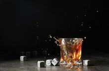 Glass With Liquor Splash And W...