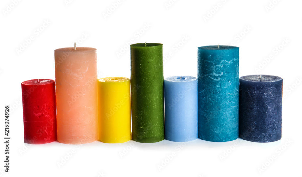 Fototapety, obrazy: Different colorful wax candles on white background