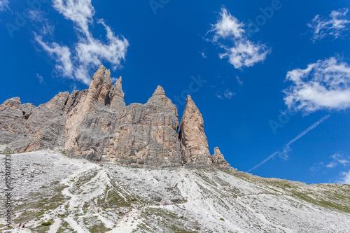 Fotografie, Obraz  Column of tourists walking at the foot of the Tre Cime di Lavaredo, Dolomites, I