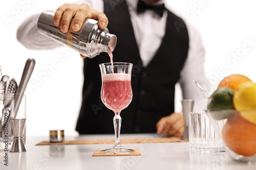 Bartender pouring his signature cocktail in a glass Wallpaper Mural