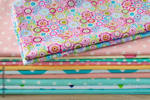 Fotobehang Stof Colorful cotton fabric. A lot of cotton fabric for sewing clothes or bedding. Natural cloth and tailoring.