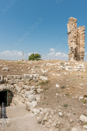 Foto op Aluminium Oude gebouw Exterior view of Aya Tekla underground cave Church gate and Great basilica also known as Saint Aya Thecla or Aya Thekla, is ruined historic church located in Silifke,Mersin,Turkey.