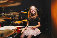 Boy Plays Drums In Recording Studio