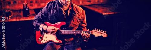Young man playing guitar  - 215104954