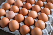 Fresh Chicken Eggs Eggs In Paper Tray,egg Carton On Wooden Background.