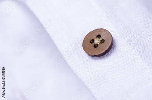 Stickers pour porte Macarons White shirt button fabric macro material clothes detail on blur background