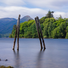 The Remains Of An Old Pier On Derwent Water At Keswick Being Used To Frame The Hills Beyond.