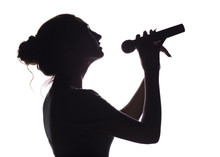 Silhouette Of Beautiful Girl Singing Into Microphone, Profile Of Young Woman Face Performing Lyric Song On White Isolated