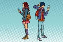 Young Man And Girl. Teen Couple With Smartphones