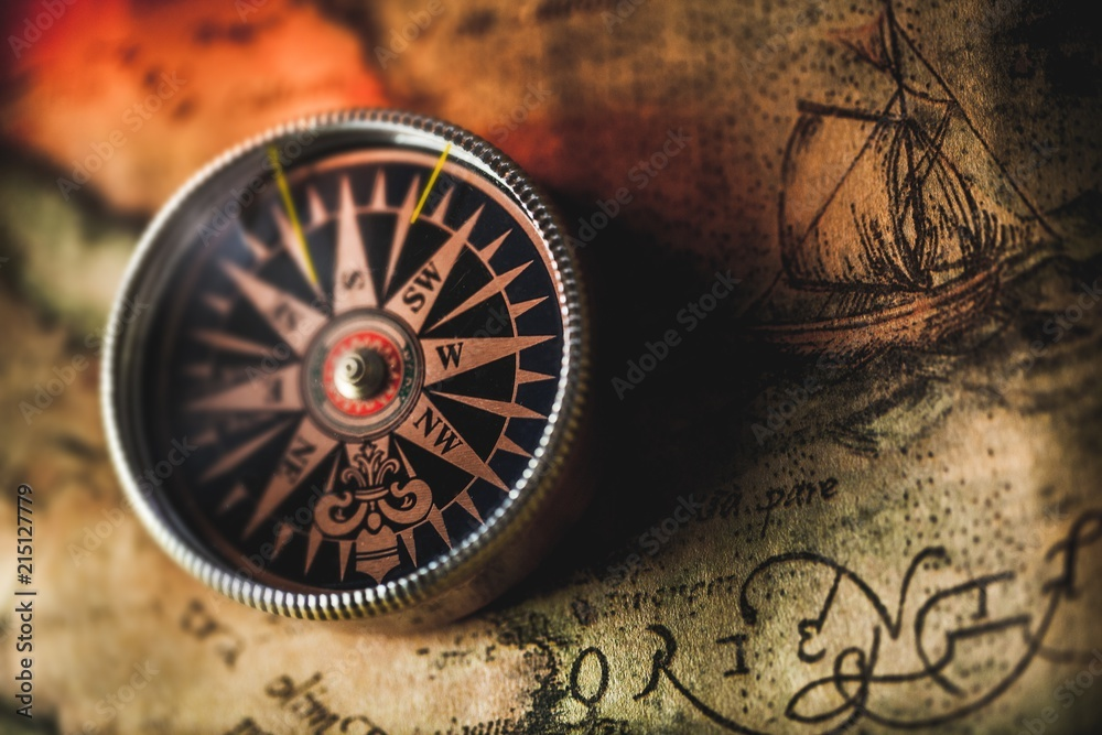 Fototapety, obrazy: Closeup of an Old Compass on an Old Map