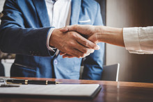 Real Estate Agent And Customers Shaking Hands Together Celebrating Finished Contract After About Home Insurance And Investment Loan, Handshake And Successful Deal