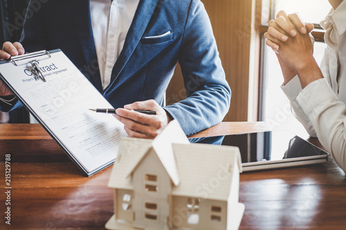Real Estate Broker Agent Presenting And Consult To Customer To