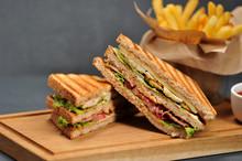 Club Sandwich On A Wooden Boar...