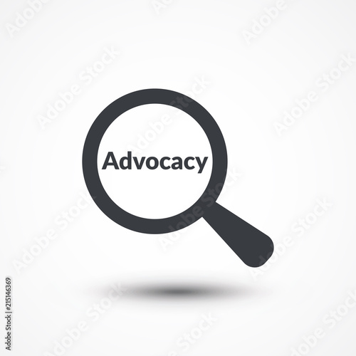 Photo Magnifying glass with word advocacy on white background
