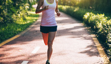 Healthy Woman Runner Running O...
