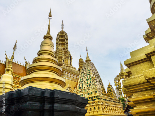 Fotobehang Bedehuis Golden buddhist temple with stupa, replica of an ancient thai temple in Ancient City at Muang Boran in Thailand, Buddhavas of the Substanceless Universe