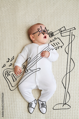 Valokuva Little baby girl sketched as rock star