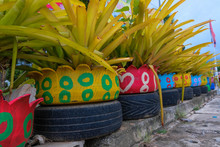 Colored Green Planters Made From Recycled Tires.