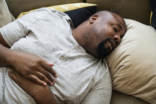 Man asleep in his bed Wallpaper Mural