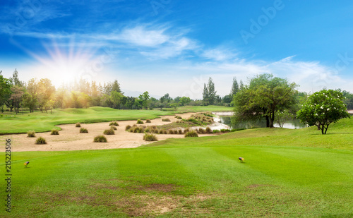 Beautiful landscape of golf course in the countryside in sunset, sunrise time. Asia, Thailand.