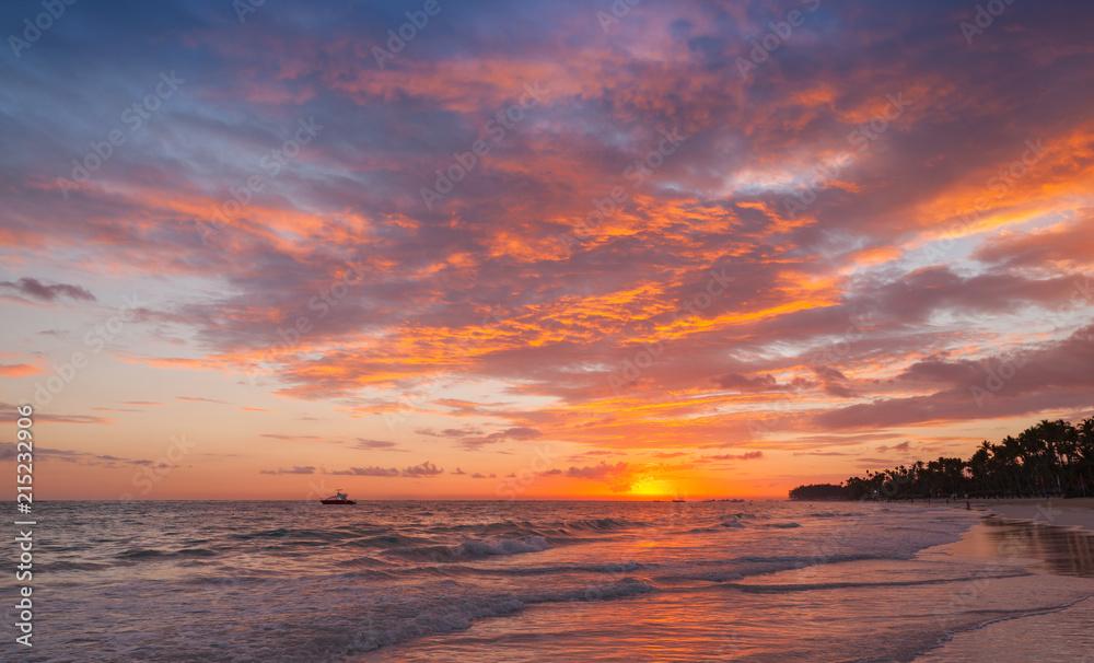 Fototapeta Colorful clouds in sunrise over Atlantic Ocean