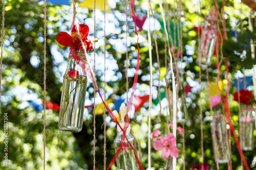 Floral Decoration In The Form Of Glass Mini Vases And Bouquets Of