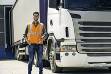 Worker Standing In Front Of Lorry