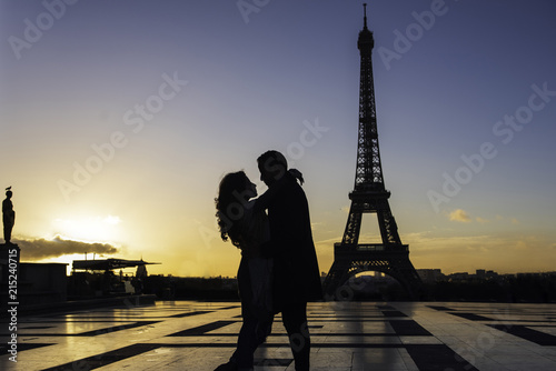 Couple embracing at Eiffel Tower - 215240715