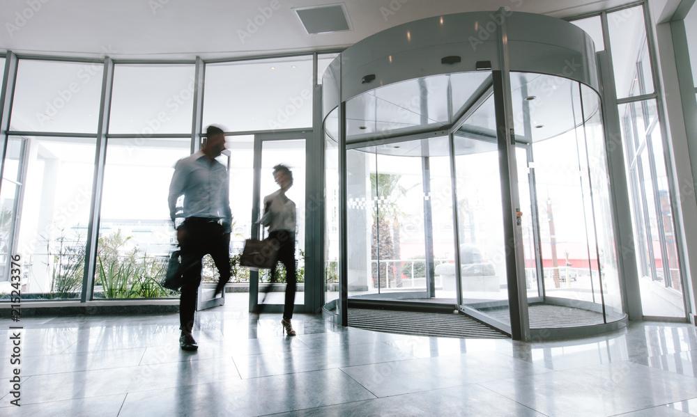 Fototapeta People walking in office entrance hall