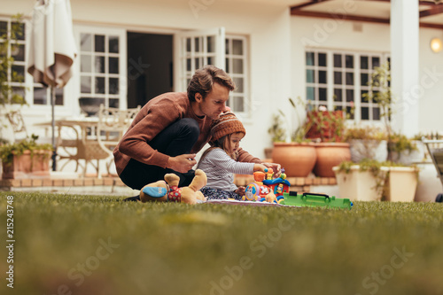 Father and daughter playing in their backyard Canvas Print