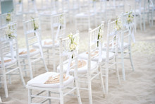 Side View Of White Chiavari Ch...