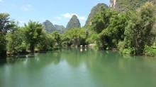 Tourists Ride On Bamboo Rafts At Li River. Yangshuo, Guilin, Guangxi Zhuang, China